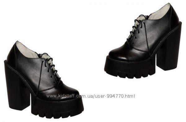 Кожаные стильные ботильйоны на каблуке