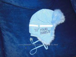 Зимняя очень теплая шапка фирмы ТУ ТУ
