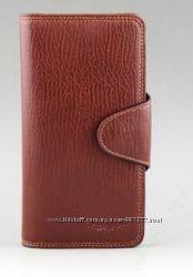 Коричневый кожаный кошелек в наличии