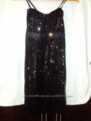 Продам эксклюзивное молодежное платье черного цвета с поетками 44 размера