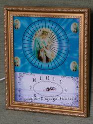 Икона Богоматери в светящихся часах