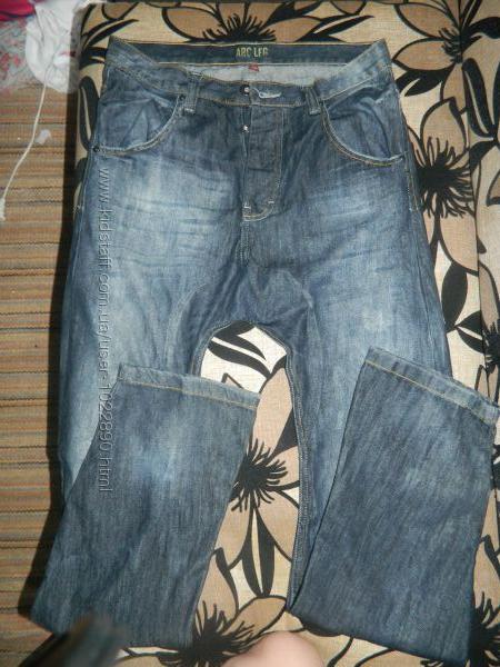 Стильные джинсы Denim приспущена матня