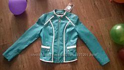 Новая куртка с биркой