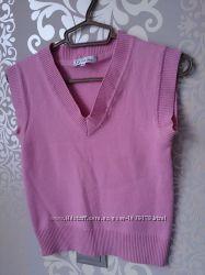 Шерстяная женская жилетка розового цвета от Sela размер S