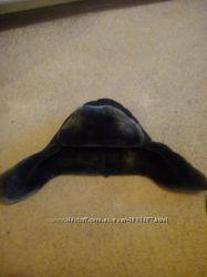 Продам зимнюю шапку на мальчика от 10-13 лет верх  плащевка