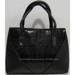 Женская сумка с лаковыми вставками