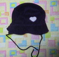 Очаровательную шапку-шляпку. Теплая