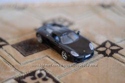 машинка модель 143 Porsche Carrera GT от Cararama
