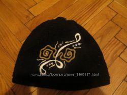 Теплая вязанная шапка