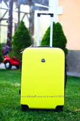 Желтый средний пластиковый чемодан без предоплаты Валіза пластикова середня