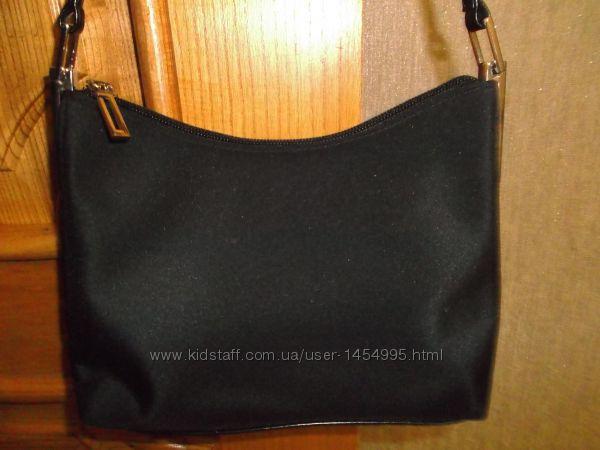 Оригинальная маленькая сумочка.