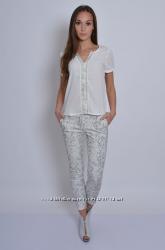 Белые штаны Terranova со змеиным принтом