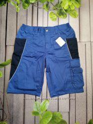 Синие рабочие шорты с множеством карманов