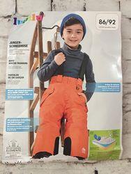 Лыжные штаны на подтяжках цвет оранжевый в паковке