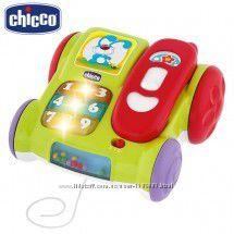 Chicco игрушка каталка телефон