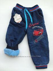 Тёплые джинсы на мальчика 1-2года с манжетами снизу.